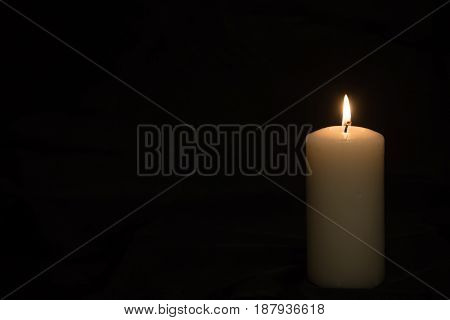 Candle Flame On A Dark Background