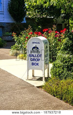 Corvalis, OR, USA - 07/14/2015: Official Ballot Drop Box outside the Courthouse in Corvallis Oregon