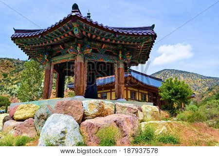 Buddhist Temple with a Peace Bell taken in the rural mountains