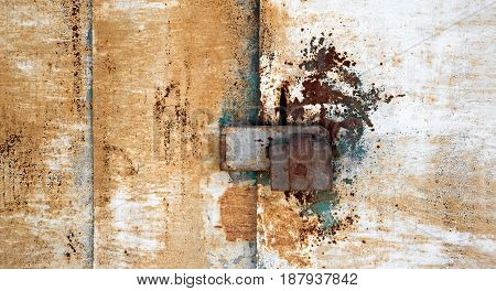 abstract background with holes and locking screws and the texture of the rust orange-brown with spots.