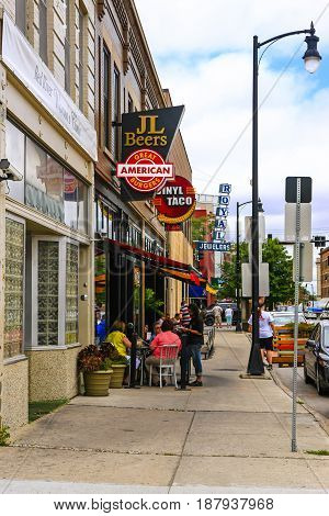 Fargo, ND, USA - 07/24/2015: Overhead signs of Fast food joints and bars on 5th Ave in downtown Fargo N. Dakota