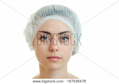 Portrait of a young girl without serious medical cosmetics and hair Cap close-up isolated on white background