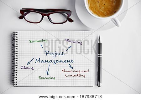 Business concept. Notebook with scheme of PROJECT MANAGEMENT on white background