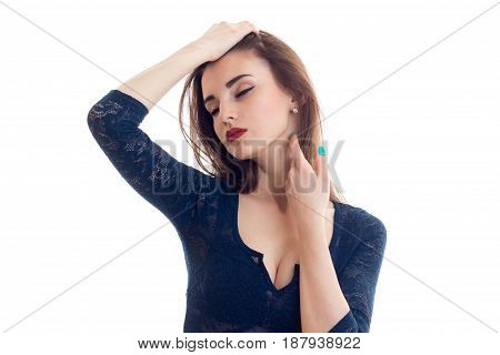 Portrait of a romantic, beautiful girl with red lipstick on lips which is tilting her head and closing his eyes close-up isolated on white background