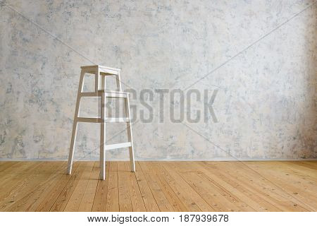 wooden staircase stands in a room with a white wall
