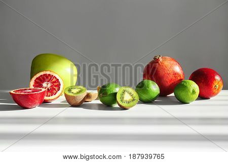 Beautiful composition with fresh fruits on light background