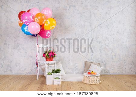 Chair and balloons, flowers basket and cake birthday