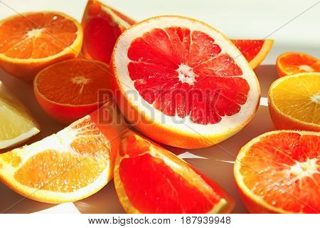 Beautiful composition with citrus fruits on white background