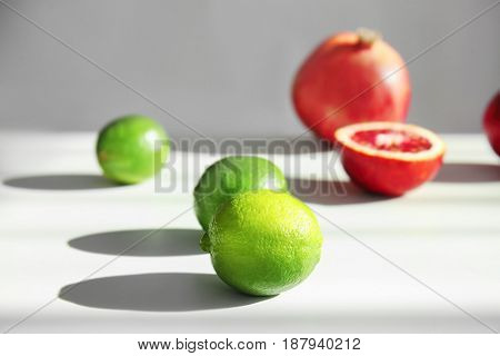 Beautiful composition with citrus fruits on light background