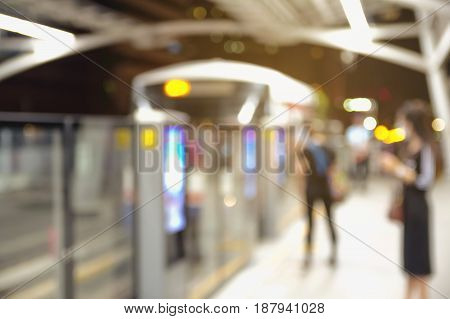 Abstract Blurred image of a queue of passengers at indoor train station, Image of Abstract Blur train station at street