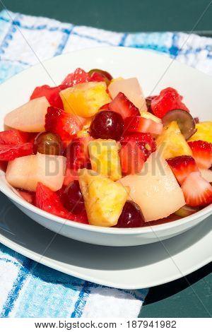 summer mix fruit salad outdoor shot closeup