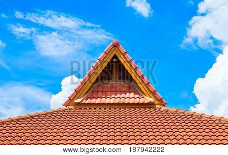roof from a metal tile on a blue sky background