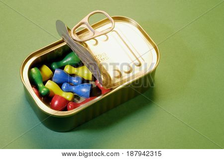 Game Pieces in Tin Can on Dark Green Background