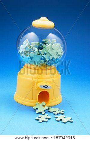 Puzzle Pieces in Bubblegum Machine on Blue Background