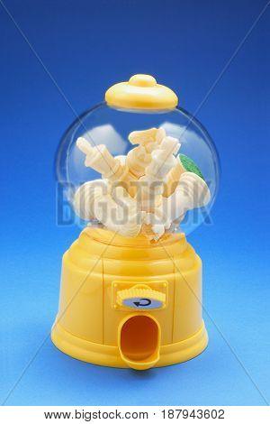 Chess Pieces in Bubblegum Machine on Blue Background