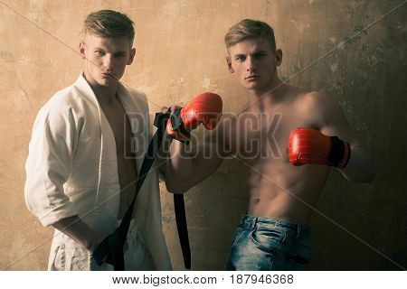 Athletic Men Twins In Karate Kimono And Boxing Gloves