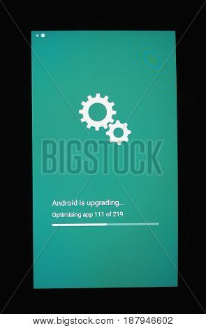 MOUNTAIN VIEW USA - CIRCA FEBRUARY 2017: Android OS installing system update on a smartphone mobile device