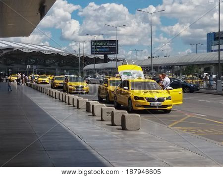 PRAGUE CZECH REPUBLIC - CIRCA JULY 2016: row of yellow taxis waiting for costumers in front of the airport