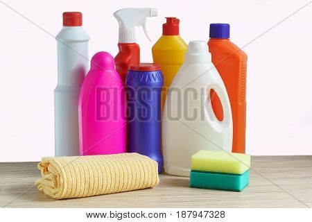 Colorful bottles of cleaning products sponge and rag for cleaning the home on white background