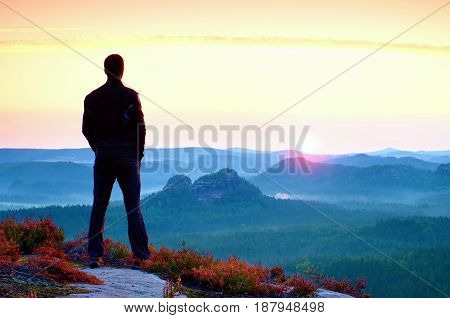 Awakening Of Sun. Hiker In Sportswear Stand On The Peak Of Sandstone Rock In Rock Empires Park And W