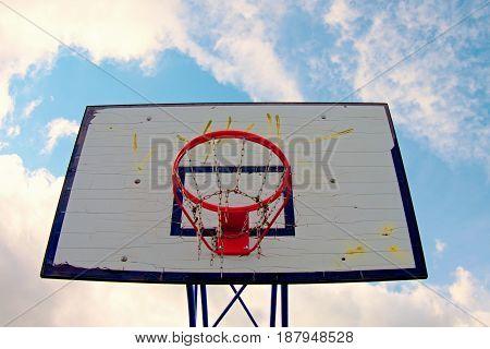 Old Worn Basketball Hoopand  Blue Sky