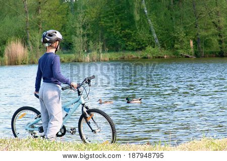Small Boy, Bikerider In Sport Helmet  On The Beach.
