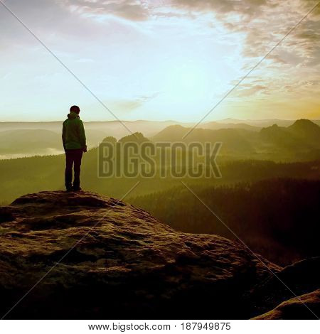 Hiker Stand On The Sharp Corner Of Sandstone Rock In Rock Empires Park And Watching Over The Misty A