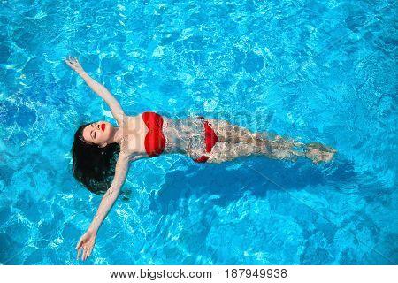 Fashion Idyllic Sexy Bikini Tanned Woman Swimming On Surface Of Ocean Water At Tropical Luxury Resor