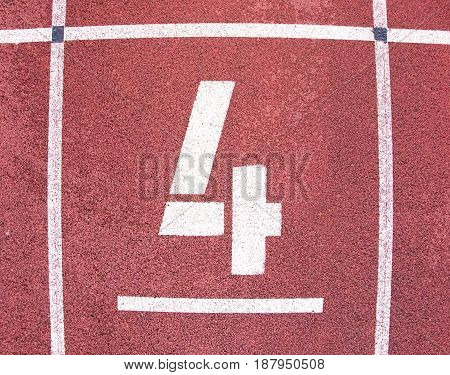 Number Four. White Track Number On Red Rubber Racetrack, Texture Of Running Racetracks In Athletic S