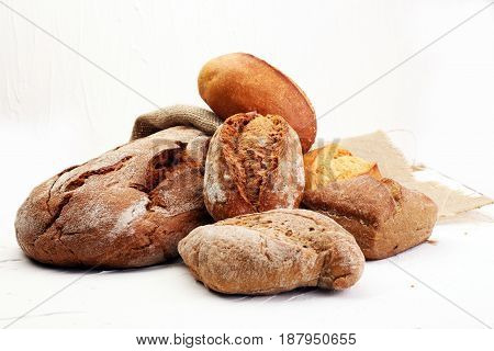 Different Kinds Of Bread And Bread Rolls On Board From Above. Kitchen Or Bakery Poster Design.