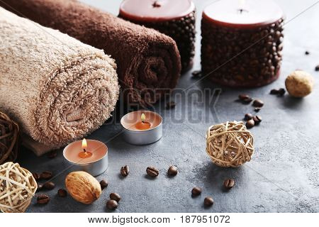 Towels With Candles On Grey Wooden Table