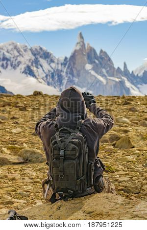 Man Taking Photos Of Andes Mountains. Patagonia - Argentina