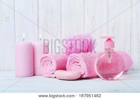 Pink Towels With Soap And Wisp On White Wall Paneling Background