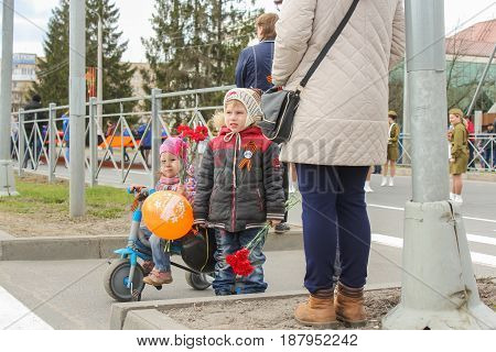 Kirishi, Russia - 9 May, Little children with flowers, 9 May, 2017. Preparation and conduct of the action Immortal regiment in small cities of Russia.