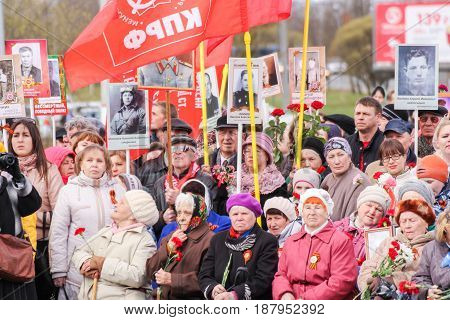 Kirishi, Russia - 9 May, People with portraits and flags, 9 May, 2017. Holding a festive rally dedicated to the Victory Day.