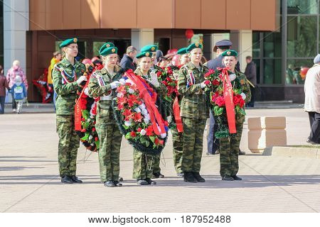 Kirishi, Russia - 9 May, Group with wreaths for laying, 9 May, 2017. Preparation and conduct of the action Immortal regiment in small cities of Russia.