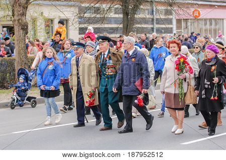Kirishi, Russia - 9 May, Veterans of war at the head of the column, 9 May, 2017. Preparation and conduct of the action Immortal regiment in small cities of Russia.