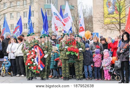 Kirishi, Russia - 9 May, Different people with flags and wreaths, 9 May, 2017. Holding a festive rally dedicated to the Victory Day.