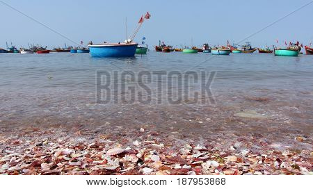 Symbol of the resort of Mui Ne - round boats Vietnam South China Sea Pacific Ocean.