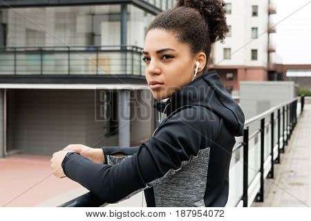 Portrait of a young woman wearing sports clothes outdoors