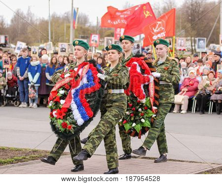 Kirishi, Russia - 9 May, Crowned group of girls, 9 May, 2017. Holding a festive rally dedicated to the Victory Day.