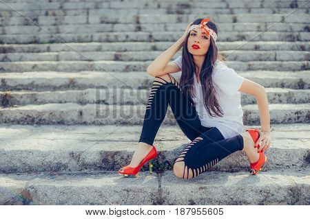 Fashion Style Long Hair Woman Posing On The Stairs