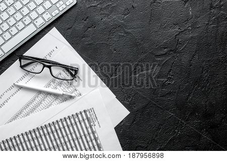 business accounter work with taxes and keyboard on black office desk background top view space for text