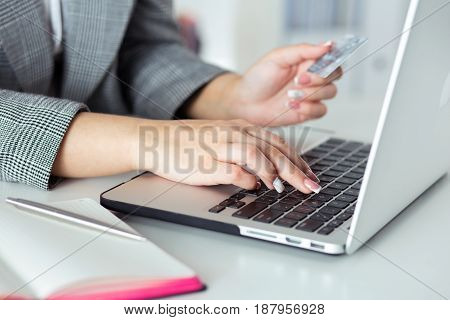 Close Up View Of Businesswoman Hands Holding Credit Card And Making Online Purchase