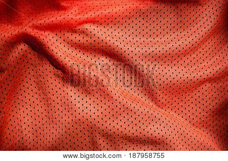 Close Up Of Red Polyester Nylon Sportswear Shorts To Created A Textured Background