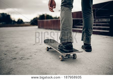 Man is going to skateboarding on the road, people, sport and skateboarding. concept of active recreation. Monochrome and high contrast.