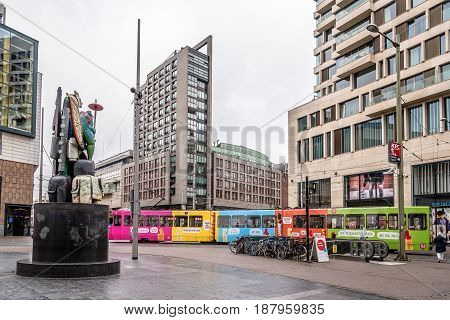 The Hague The Netherlands - August 7 2016: Street view in the Hague with multicolored bus a cloudy day of summer.