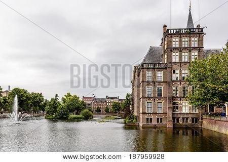 Hague Netherlands - August 7 2016: Hofvijver Court Pond artificial lake beside the Binnenhof. Binnenhof is a complex of buildings in the city centre of The Hague. Office of the Prime Minister and House of Representatives.