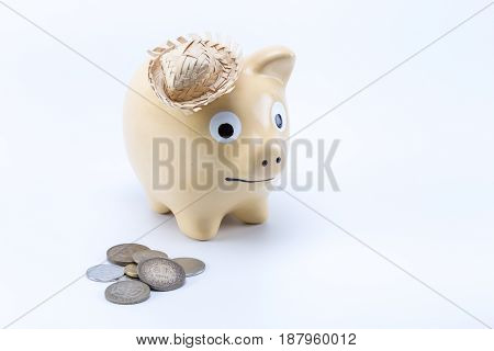 Brown Country Piggy Saving Bank Moneybox With Coins In The Front Of It Isolated On White Background