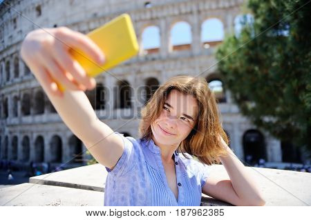 Young Traveler Making Selfie Photo Standing The Colosseum In Rome